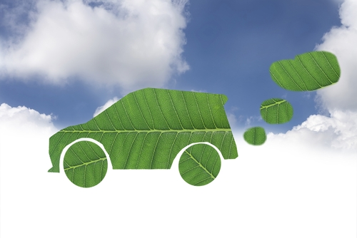 A green car helps out the environment.