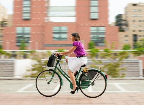 One woman bikes to work.